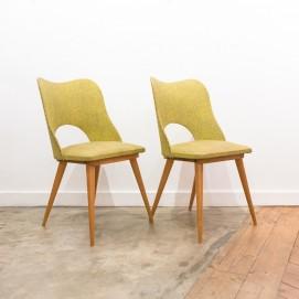 Paire de chaises tonneau en Skaï